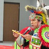 Staff photo by Cathy Spaulding<br /> Native American dancer/educator Mike Pahsetopah explains an Indian flute during a demonstration in Fort Gibson.