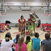 Staff photo by Cathy Spaulding<br /> Lisa and Mike Pahsetopah lead Intermediate Elementary students in a social dance while other students watch. The Pahsetopahs visited Fort Gibson.