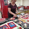 CATHY SPAULDING/Muskogee Phoenix<br /> Hilldale Elementary emergency medical technician Dorsinda Wiedel, who is retiring after 29 years at Hilldale, serves cake honoring school retirees.