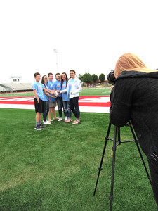 Staff photo by Cathy Spaulding Students pose for Carlee Fugate with a soccer ball.