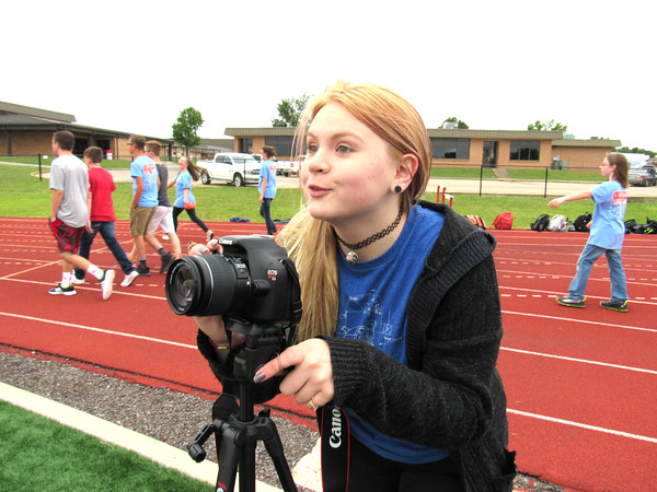 Staff photo by Cathy Spaulding<br /> Fort Gibson Middle School seventh-grader Carlee Fugate sets up a photograph at the walk-a-thon, which she organized.
