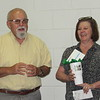 CATHY SPAULDING/Muskogee Phoenix<br /> Creek Elementary Principal Rick Hoos praises Creek secretary Thea Speer, who was named Muskogee Public Schools Employee of the Year at Tuesday's Board of Education meeting.