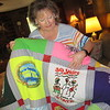 CATHY SPAULDING/Muskogee Phoenix<br /> Tamra Scherer admires a quilt she received upon retiring from Muskogee Public Schools. The quilt commemorates her work with Camp Bennett and Special Olympics.