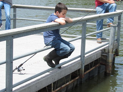 CATHY SPAULDING/Muskogee Phoenix Cooper Atkinson, 10, of Bixby waits on the Greenleaf Lake fishing dock for a bite. The boy enjoyed a Saturday fishing expedition with his father and grandfather.