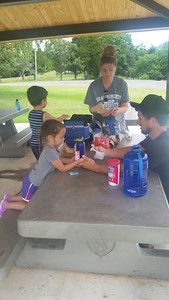 CATHY SPAULDING/Muskogee Phoenix. The Sheppard family of Broken Arrow — from left, Beckett, 2, Aspen, 4, mother Brittany Sheppard and father Chad Sheppard — prepare to eat at a Greenleaf State Park picnic table Saturday.