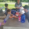CATHY SPAULDING/Muskogee Phoenix.<br /> The Sheppard family of Broken Arrow — from left, Beckett, 2, Aspen, 4, mother Brittany Sheppard and father Chad Sheppard — prepare to eat at a Greenleaf State Park picnic table Saturday.