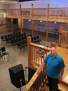 CATHY SPAULDING/Muskogee Phoenix Timothy Baptist Church Pastor Kelly Payne stands on the Kilharen's Lodge grand stairway, overlooking their main hall. The church recently bought the event center and will use it for fellowship hall and youth building.