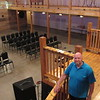 CATHY SPAULDING/Muskogee Phoenix<br /> Timothy Baptist Church Pastor Kelly Payne stands on the Kilharen's Lodge grand stairway, overlooking their main hall. The church recently bought the event center and will use it for fellowship hall and youth building.