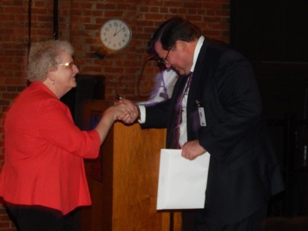 Staff photo by Mark Hughes Janet Lanier is greeted Tuesday by Tony Young, chief executive officer for EASTAR Health System, during an employee service award luncheon at Oklahoma Music Hall of Fame. Employees with five to 45 years of service were recognized. Lanier was one of three people with 30 years of service. The other two were Steven Foutch and Larry Hall. Sharon Freeling and Doug Stanley were recognized for 35 years, Shelly Haney had 40 years, and Michale Shearrer had 45 years of service. Shearrer said that when he began working at Muskogee General Hospital, its vending machines contained cigarettes.