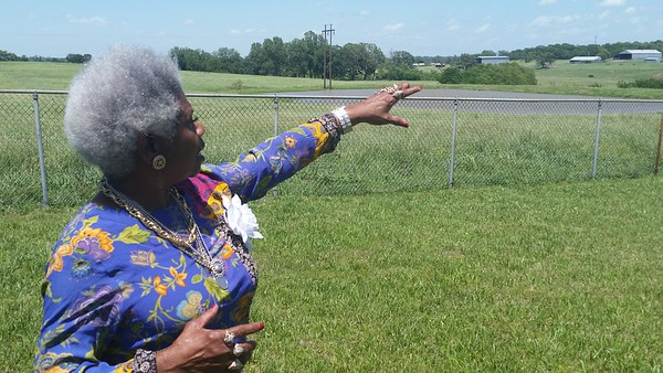 Staff photo by Cathy Spaulding<br /> Taft Trustee Lelia Davis shows the site of a former cemetery for the Deaf, Blind and Orphan Institution that operated in Taft until 1961. Taft officials will mark Memorial Day at 4 p.m. Monday by laying wreaths at the site and at a cemetery used by an institution for black mental patients.
