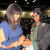 CATHY SPAULDING/Muskogee Phoenix<br /> Charlotta Brown, left, adjusts a bracelet for her daughter, Muskogee High School senior D'India Brown, before the MHS commencement ceremony Friday. D'India Brown is the youngest of 11 Brown children to graduate from MHS.
