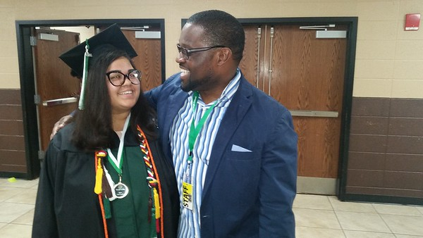 CATHY SPAULDING/Muskogee Phoenix<br /> Muskogee High School senior Abbey Wood-Griffin gets a hug from math teacher Andrae Freeman right before the MHS commencement ceremony on Friday.