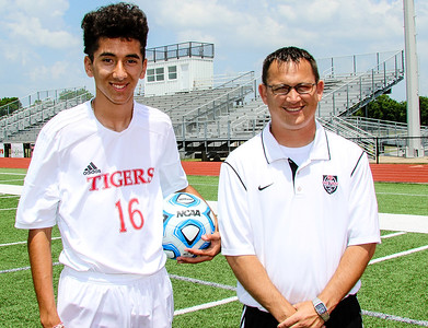 Phoenix special photo by John Hasler MVP Yassine Kharrazi and Coach of the Year Todd Friend, both from Fort Gibson's state championship team.