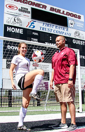 Phoenix special photo by John Hasler<br /> Wagoner's Darci Masten, the All-Phoenix girls MVP and the girls Coach of the Year, her coach, Brandon Carr.