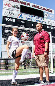Phoenix special photo by John Hasler Wagoner's Darci Masten, the All-Phoenix girls MVP and the girls Coach of the Year, her coach, Brandon Carr.