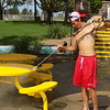 MIKE ELSWICK/Muskogee Phoenix<br /> Ryan Parisotto, lifeguard at River Country Water Park, was among staffers busy in recent days helping get the park ready to open on Saturday.