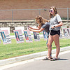 CATHY SPAULDING/Muskogee Phoenix<br /> Fort Gibson High School senior Brooklyn Bridges, right, admires yard signs honoring each member of the Class of 2020, while her mother, Mandy Neffendorf, leans to take a photo. The signs were displayed over the weekend at the school district entrance.