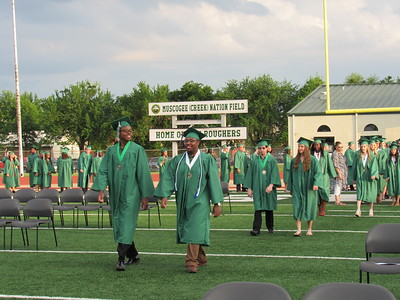 Staff photo by Cathy Spaulding Muskogee High School's Class of 2017 walk across Muscogee (Creek) Nation Field during Friday's MHS Commencement ceremony.