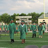 Staff photo by Cathy Spaulding<br /> Muskogee High School's Class of 2017 walk across Muscogee (Creek) Nation Field during Friday's MHS Commencement ceremony.
