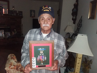 Staff photo by Mark Hughes Displaying his Korean War ribbons and badges is Army PFC Benito Anguino, 84. In 1950, Anguino and his 42-man unit arrived in Pusan, South Korea. Days later his unit was under attack, and when it ended nine soldiers remained. Anguino was a prisoner of war for more than three years.