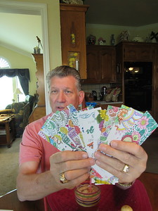 Staff photo by Cathy Spaulding Larry Hoffman turns a hobby into a ministry by coloring his own bookmarks.