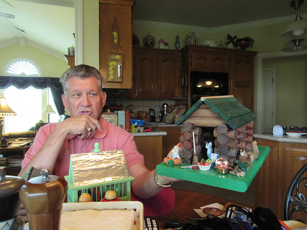Staff photo by Cathy Spaulding Larry Hoffman makes bird houses out of Lincoln Logs and other items. He works on the houses when he's not working on Habitat for Humanity houses.