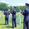 WENDY BURTON/Special to the Phoenix<br /> Members of the Tinker Air Force Base Honor Guard perform a rifle volley during a Memorial Day ceremony at Fort Gibson National Cemetery.