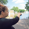 CATHY SPAULDING/Muskogee Phoenix<br /> Teresa Castro shows flooded trailers at Riverside Mobile Home Park on Monday.Castro said she managed to get items from her house.