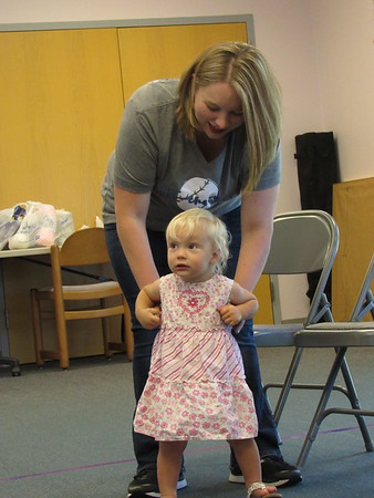 CATHY SPAULDING/Muskogee Phoenix<br /> Megan Ottenbacher helps her 18-month-old daughter, Autumn, dance and get moving before a story time at Q.B. Boydstun Library. A Health Literacy grant enables the library to offer programs on exercise and healthy eating.