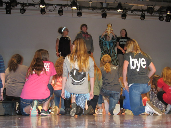 "Staff photo by Cathy Spaulding<br /> Animals of Africa bow in homage to a newborn lion cub in this scene from ""The Lion King Jr."" Fort Gibson Middle School students are rehearsing the production, which runs this week."