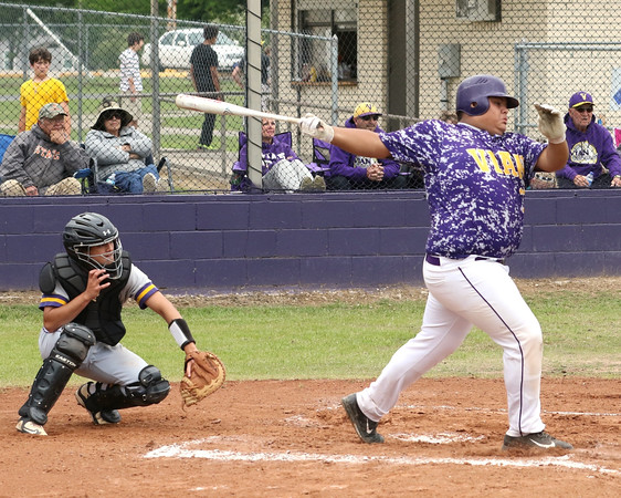 Special photo by John Hasler<br /> Vian's Josh Bolin rips a 2-run single to get the scoring started in the second inning of the Wolverines' Class 3A district playoff game against Westville on Monday in Vian. The Wolverines run-ruled the Yellowjackets 16-0 to win the district championship series 2-1.
