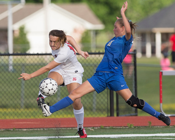 Phoenix special photo by Von Castor<br /> Fort Gibson's Brooke Hatchette takes a shot on goal (right) as Claremore Sequoyah's Ashlyn Rutledge defends Tuesday afternoon at Fort Gibson.