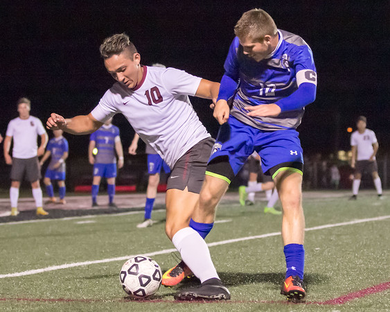 Phoenix special photo by Shane Keeter<br /> Wagoner's Braulio Aguilar, left, fights for possession against C.J. Rumley of Glenpool on Tuesday.