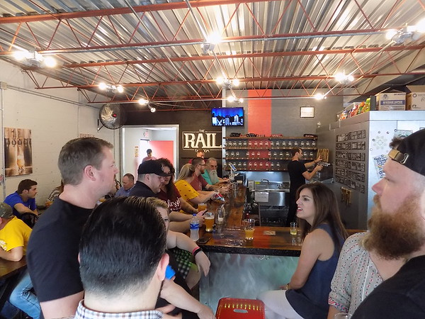 MIKE ELSWICK/Muskogee Phoenix<br /> The Rail Taproom was busy on Tuesday evening as the venue specializing in craft beers held a special event. In the near future an outdoor stage, game area and seating area will be added to the location.