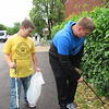 CATHY SPAULDING/Muskogee Phoenix<br /> Oklahoma School for the Blind student Rayce Phillips, left, accompanies schoolmate Austin Wade as they clean the Gospel Rescue Mission grounds Wednesday during OSB Gives Back Day.