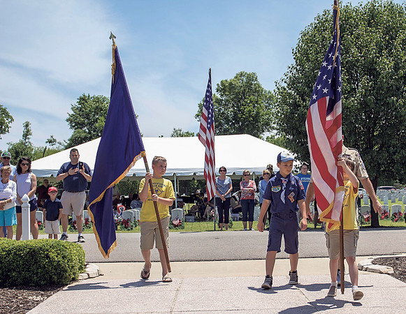 Special photo by Travis Sloat<br /> Members of the Fort Gibson Boy Scouts, Pack 638, perform the Posting of the Colors at Fort Gibson National Cemetery's annual Memorial Day program Monday.