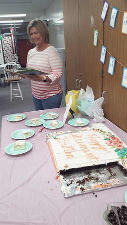 Staff photo by Cathy Spaulding<br /> Math teacher Britton Nevitt's high school colleagues gave her cake and a memory book during a recent reception. Nevitt said her fellow teachers are like family.