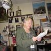 Staff photo by Cathy Spaulding<br /> Travel posters and academic team trophies surround Eva Galluzzi as she reads a student's card congratulating her on her retirement from Hilldale Public Schools, where she taught for 30 years.