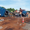 Staff photo by Cathy Spaulding<br /> Workers cover fuel leaking from a tractor-trailer rig that overturned Monday morning south of Muskogee on the Muskogee Turnpike shortly before 8:30 a.m.