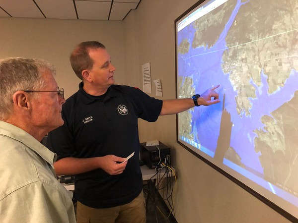 D.E. SMOOT/Muskogee Phoenix<br /> Muskogee County Emergency Management Director Jeff Smith, right, points out for U.S. Sen. James Inhofe on Thursday some of the areas hit hardest by near-record flooding that has occurred this past week along the Arkansas River.
