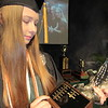 CATHY SPAULDING/Muskogee Phoenix<br /> Muskogee High School graduate Brookelyn Gilmore shows her name among others on the Noel Buck Ballard Award she received Wednesday at the 2019 Senior Awards and Scholarship Program.Gilmore played second base for MHS softball teams and graduated Summa Cum Laude.