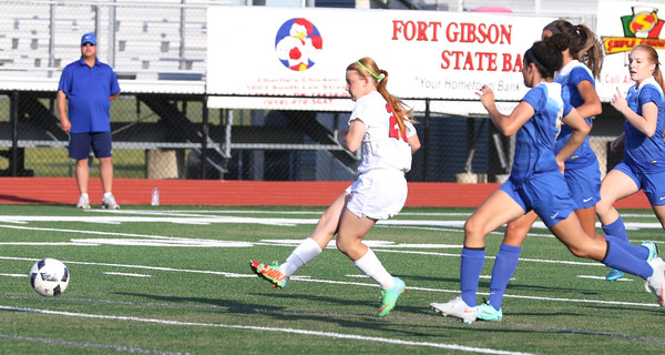 Phoenix special photo by John Hasler<br /> Fort Gibson's Courtney, left, gets past the Claremore Sequoyah defense and scores on of her two goals on the night at the Lady Tigers beat the Lady Eagles 4-2 in Tuesday's Class 4A playoff game at Leo Donahue Tiger Stadium.