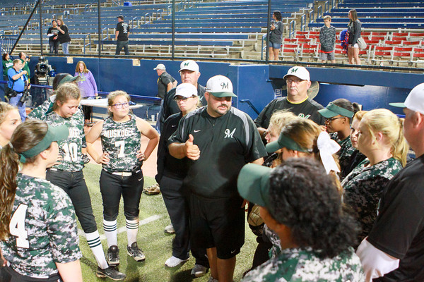 Phoenix special photo by Samuel Perry<br /> Muskogee coach Keith Coleman, center, talks to the Lady Roughers following their 15-4 loss to Southmoore in Tuesday's Class 6A state championship game at ASA Hall of Fame Stadium in Oklahoma City. The game was Coleman's last game as Muskogee's head coach.