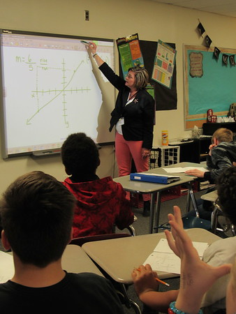 Staff photo by Cathy Spaulding<br /> Hilldale Middle School math teacher goes beyond the boundaries of her Smart Board screen to demonstrate sixth-grade math. She is Hilldale's 2017 Teacher of the Year.