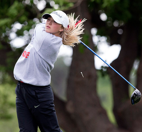 Phoenix special photo by Von Castor<br /> Hilldale's Kenzie Kirkhart tees off on the ninth hole at Lake Hefner South Golf Course in Oklahoma City. Kirkhart's 76 is atop the Class 4A state tourney scoreboard with the final round today.