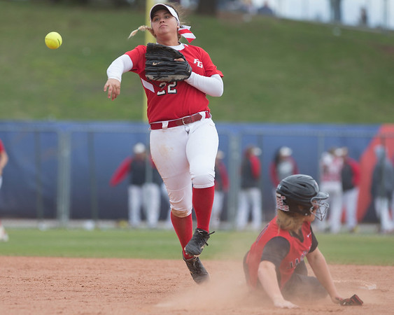 Phoenix special photo by Von Castor<br /> Fort Gibson shortstop Aubree Bell tries to turn a double play Wednesday against Westmoore.