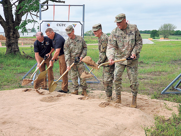 CHESLEY OXENDINE/Muskogee Phoenix<br /> (From left) Camp Gruber Fire Department Deputy Chief Doug Owens, Fire Chief Lee Horst, Lt. Col. Cory Newcomb, Col. Jerald Gilbert, and Major General Michael Thompson break ground on the site of a new fire station being constructed at Camp Gruber.