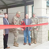 CHESLEY OXENDINE/Muskogee Phoenix<br /> Major General Michael Thompson (center), joined by Oklahoma Senator Dewayne Pemberton, R-Muskogee, cuts the ribbon on a new organizational readiness training center just completed at Camp Gruber.