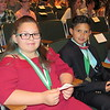 Staff photo by Cathy Spaulding<br /> Tony Goetz Elementary fourth-graders Trinity Knott and Gabriel Quemado already had honors medals when they arrived at the Superintendent's Academic Honors Awards Program, held Thursday at Muskogee High School.