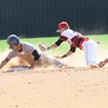 Phoenix special photo by John Hasler<br /> Fort Gibson's Jessie Rudd slides safely into second base, ahead of the tag by Hilldale's Dee Folsom, during Thursday's first game of the Class 4A regional at Hilldale High School. The Tigers beat the Hornets 9-3.